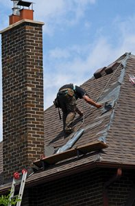 man working on a new roof