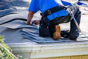 men replacing roof
